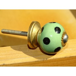 Small green handles with black dots
